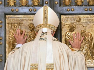 Pope Francis opens the Holy Door of Saint Peter's Basilica, formally starting the Jubilee of Mercy, at the Vatican City, 08 December 2015. ANSA/MAURIZIO BRAMBATTI